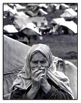 Refugee at her home - a refugee camp.